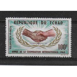 TCHAD POSTE AERIENNE 1965 : Année de la coopération internationale - Timbre 100 F. sépia, vert-bleu, or et carmin NEUF *
