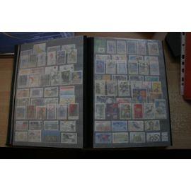 lot de 1500 timbres oblitérés dans album a bandes