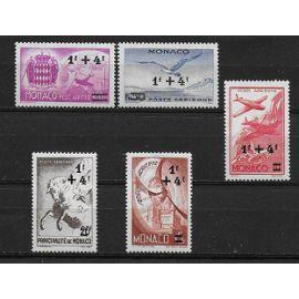 MONACO POSTE AERIENNE 1945 : Symboles - Série entière de 5 timbres NEUFS * surchargés